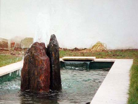 formal pond with standing stones and geyser
